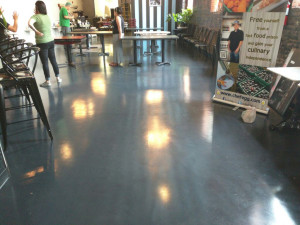 custom epoxy floor in grey created for trade show